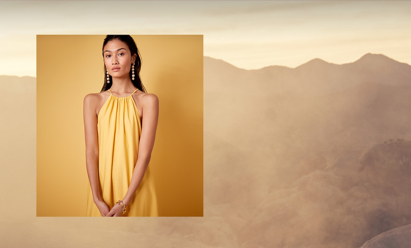 Campaign: Golden Hour. Image of woman in yellow dress with landscape background